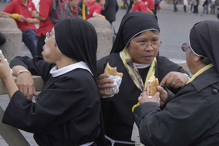 nuns: ITALY . ROMEVATICAN_ Asia ncatholic  nuns lunch break and talking  about serious point at St.peter sqaure on 13 Otcober 2010