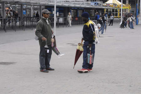 aas: ITALY  GENOA .Asian and african males working aas vendors in Genoa itdaly on October 11, 2010