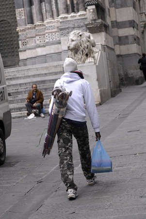 aas: ITALY  GENOA .Asian and african males working aas vendors in Genoa itdaly on October 11, 2010   Editorial