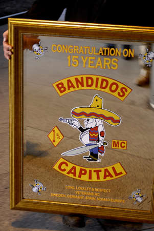 miror: DENMARK  COPENHAGEN .Miror glass with text 15 years jubelee celebration of swedish bandidos  Editorial