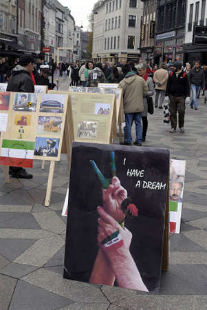immigrants: DENMARK  COPENHAGEN . Iranian immigrants living in Denmark displayed playcards and playboards with message brutal treatement of iranian Regim in Iran, cards are display at Amager torv Copenhagen today on saturday 23 October 2010