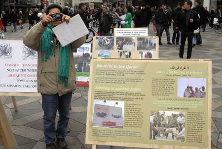 immigrants: DENMARK  COPENHAGEN . Iranian immigrants living in Denmark displayed playcards and playboards with message brutal treatement of iranian Regim in Iran, cards are display at Amager torv Copenhagen today on saturday 23 October 2010  Editorial
