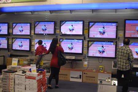 hi fi: DENMARK  COPENHAGEN . Femal looking at wide and flat screen television in hi fi shtore in Fields 31 October 2010     Editorial