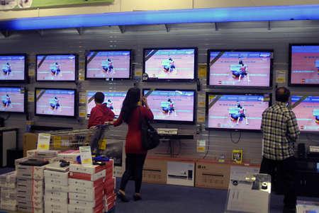 hi fi: DENMARK  COPENHAGEN . Femal looking at wide and flat screen television in hi fi shtore in Fields 31 October 2010