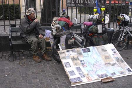 DENMARK / COPENHAGEN .Adelino Manuel Lopes biker from Portgal eating breakfast on stroget in Copenhagen he started his  tour world wide in 2003 and has cover over 47.000 kilometer , passing by Copenhagen today 11 Nov. 2010   Stock Photo - 8185385