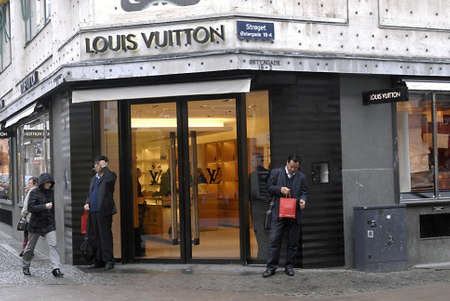 louis vuitton: DENMARK  COPENHAGEN . Louis Vuitton store and tow asian men with shopping bags