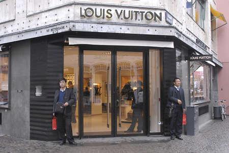 louis vuitton: DENMARK  COPENHAGEN . Louis Vuitton store and tow asian men with shopping bags 12 Nov. 2010