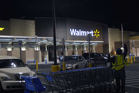 walmart: UNITED STATES  WASHINGTON STATECLARKSTON. Shoppers at evening at Walmart super center and  cashers put all items in plastic bags and bags are free at cost   Marach 9, 2010 .