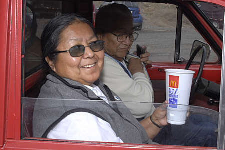 eldlery: UNITED STATES  IDOHA STATENEZ PERCE COUNTY,Native American  Indian eldlery counple in  auto , Clifford Allen family  female drinks drink from McDonals  march 9, 2010          Editorial