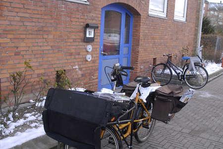 DENMARK / COPENHAGEN . Danish postman or post delivery man 01 Dec. 2010    Stock Photo - 8448672