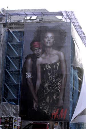 hm: DENMARK  COPENHAGEN . Black model on H&M (Hennes&Mauritz)billboard commercial 12 Dec. 2010