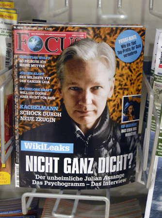 polictis: DENMARK  COPENHAGEN .Wikileaks boss Julian Assange media darling on cover of German Focus news magasine ons ale in Copenhagen Denmark at magasin du nord 06 Dec. 2010
