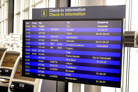 KASTRUP/COPENHAGEN/DENMARK _Copenhagen Interntional (Kastrup) airport people stranded and  Traveller inspecting flight billboard flights to Germany, UK england and France are cancelled due to heavy snow in France, England, Germany today on sunday 19 Dec.  Stock Photo - 8465962