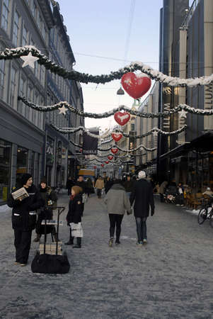 DENMARK / COPENHAGEN Tough streets are deocrated with christmas lights stars and hearts  but this Heavy cold snow winter taking toll on Christmas shoppers on stroegt snow ahs tunr into slushed and  shoppers slipped and fell on snow 21 Dec. 2010      Stock Photo - 8477526