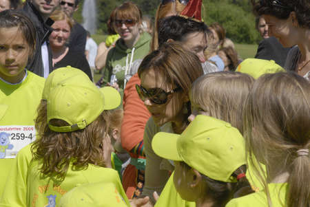 fond: K�BENHAVNCOPENHAGENDANMARK DENMARK.  H.R.H.Princess Mary participate at Bully Free event at Faelledparken, Mary Fond and danish save the children arranged event children run and mary giving medals to runners at event, mary arrives and  was welcome by s