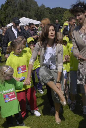 fond of children: K�BENHAVNCOPENHAGENDANMARK DENMARK.  H.R.H. Crown ary Fond and danish save the children arranged event children run and mary giving medals to runners at event, mary arrives and  was welcome by save the children general secretary  Mimi  Stilling Jokobse