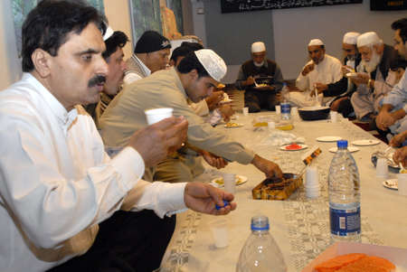 imam: DENMARK _ COPENHAGEN . Pakistani danish and immigrant communcite celevbrate first day of ramadan ,end fasting fist day at evening food or iftari  get to gether in Aamager Mosque prayer was leads by new Imam Hafiz Noor Ali Mirza (Imam islamic culture cente Editorial