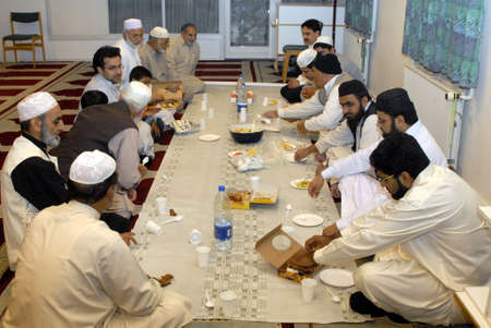 DENMARK _ COPENHAGEN . Pakistani danish and immigrant communcite celevbrate first day of ramadan ,end fasting fist day at evening food or iftari  get to gether in Aamager Mosque prayer was leads by new Imam Hafiz Noor Ali Mirza (Imam islamic culture cente Editorial