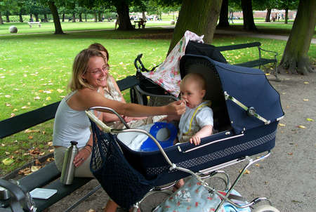 30-07-02-Kongens Have-Copenhage-Denmark,danishmother has right for full maternity benefit while on   maternity leave,but danish mother does not get fullmaternity allowance if she works in financial sector,there iks conflict in law. Stock Photo - 8500837