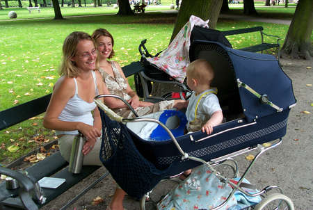 30-07-02-Kongens Have-Copenhage-Denmark,danishmother has right for full maternity benefit while on   maternity leave,but danish mother does not get fullmaternity allowance if she works in financial sector,there iks conflict in law Stock Photo - 8500835