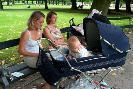 30-07-02-Kongens Have-Copenhage-Denmark,danishmother has right for full maternity benefit while on   maternity leave,but danish mother does not get fullmaternity allowance if she works in financial sector,there iks conflict in law. Stock Photo - 8500836
