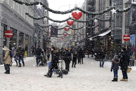 DENMARK / COPENHAGEN .Heavy Snow falls is not hinders dane to do boxing day shopping and discoun sale on boxing day shoppers in Copenhagen Denmark 27 Dec. 2010