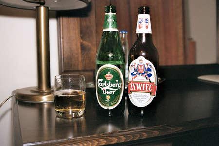 carlsberg: May 18,2004 ,Wroclaw,Poland, Polish zywiec bottle  AND danish Carlsberg bottle . Editorial