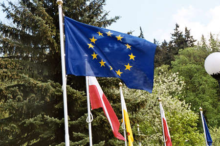 political rally: May 17,2004 Polanica Zdroj,Poland, European Union flag fling with Polish national at European Union political rally..