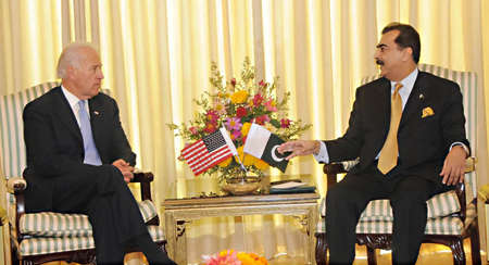 ISLAMABAD PAKISTAN. Prime Minister Syed Yusuf Raza Gilani is talking to Vice President USA, Mr. Joseph R. Biden at PMs House on January 12, 2011