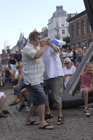 eldlery: K�BENHAVNCOPENHAGENDANMARK DENMARK.  Eldlery female enjoying dance till music and msuician daninc with male audiance at nyhavn at Copenhagen Jazzfestival band Zebrass bank Hans Leonardo Pedersen S, Hans Knudsen P,Thomas Jacobsen,Sousap,B Tobias leonard Editorial