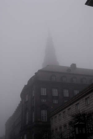 polictis: DENMARK  COPENHAGEN .  Christiansborg danish parliament tower is covered with ehavy fog today on saturday on 15 Jan 2011   Editorial