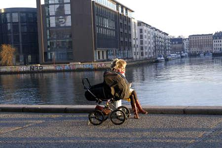 DENMARK  COPENHAGEN . Female with her baby pram out side the royal library black diament 21 Jan. 2011     Publikacyjne