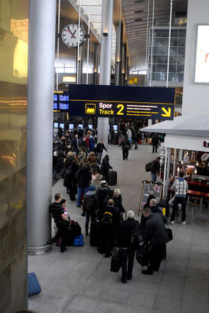 kastrup: DENMARK  COPENHAGEN_  Travellers  standing in line and arrival at Copenhagen International Airport ,danes those are stock in Copenhagen for vacations in spain are able to travel and those strangler in spain are arriving at Copenhagen International  Airpo