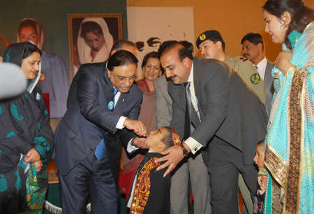 ISLAMABAD PAKISTAN.   President Asif Ali Zardari administering polio drops to an orphaned child after launching �the National Emergency Action Plan 2011 for Polio Eradication� at the Aiwan-e-sadr on January 24, 2011.