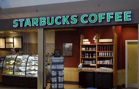 starbucks coffee: KASTRUPCOPENHAGENDENMARK _ Starbucks coffee bar at Copenhagen Kastrup  International Airport logo and coffee cups 27 Jan.2011