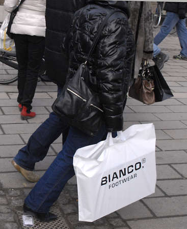 disclosed: DENMARK  COPENHAGEN . Conmsuers still shopping discount sale to promte danish economy though government has disclosed their welfare remorning in future, danes still shopping at various shops and consumer with various shopping bags 29 Jan 2011