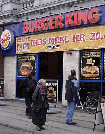 DENMARK / COPENHAGEN .  Food consumer inspecting food menu at Burger king menu 18 Feb 2011    Stock Photo - 8836923