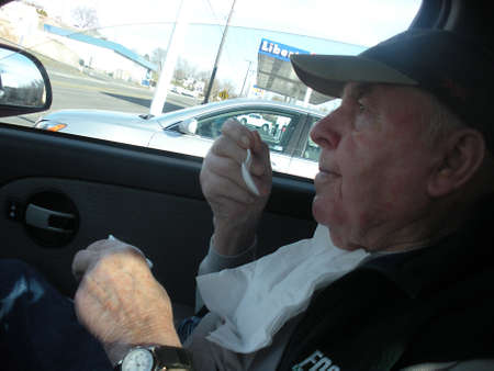 senior eating: LEWISTONIDAHOUSA _United States senior eating Hucleberrry ice cream in his car from polar beer store  14 Feb. 2011    Editorial