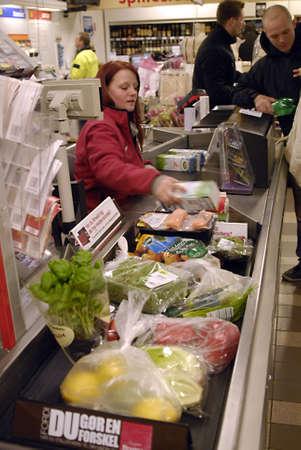 KASTRUP/COPENHAGEN/DENMARK _Vegetable and fruit shoppers 15 percent high food furit and vegetable ood prices superbrugsen food super maket ,danish wages are  still same as usual  ,18 Feb. 2011