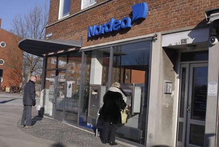 cashing: DENMARK  COPENHAGEN .Female cashing money from automat ccash box from Nordea Bank at sunbyvester 19 Feb. 2011