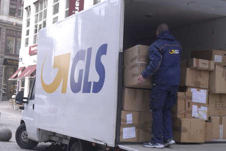 DENMARK  COPENHAGEN _  GLS worker with parcels 26 Feb. 2011          Editorial
