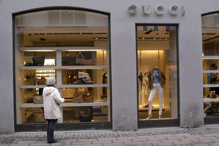 window shopper: DENMARK  COPENHAGEN _ Gucci female window shopper for luxery items 2 March 2001