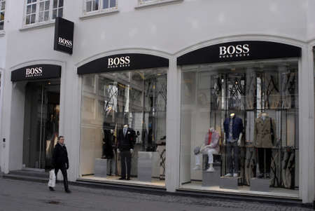 hugo: DENMARK  COPENHAGEN _  Shoppers walk by Bos Hugo Boss store 7 March 2011