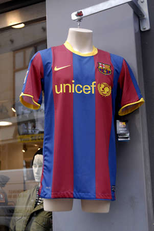 unicef: DENMARK  COPENHAGEN _ Sport T.shirt FCB Footablla club Barcelona unicef and nike on sale and male wearing t.shirt 14 March 2011
