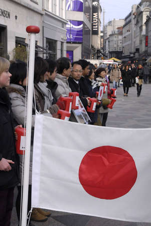 DENMARK  COPENHAGEN _ Jajapnese living in Denmark and europe collection donation to their countrymen and women Disater in Japan,Tsunami, nuclear crisis Fukushim Daiichi nuclear plant and eath quake ,people giving donation with smile to Japan Disater vict