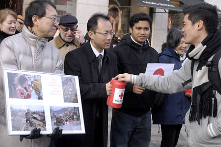 DENMARK  COPENHAGEN _ Jajapnese living in Denmark and europe collection donation to their countrymen and women Disater in Japan,Tsunami, nuclear crisis Fukushim Daiichi nuclear plant and eath quake ,people giving donation with smile to Japan Disater vict Editorial