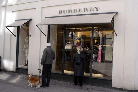 luxery: DENMARK  COPENHAGEN _Senior couple  Window shopper at Burberry shop 24 March 2011