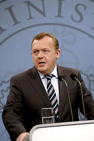 ralli: DENMARK  COPENHAGEN _ Danmrk�s prime minister Lars Loekke Rasmussen (Lars L�kke Rasmussen)holds his weekly press conference and high the future government polices and also strongly condemn regims Violent affair agains their citizen peaceful protest ralli