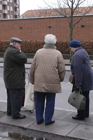eldlery: DENMARK  COPENHAGEN _ Danish senior citizens waiting for bus transport, danish seniors are not allow to travel by bus,metro or train before 9.00 am and not allow traveled on train between 3 pm untill 5 pm but bus transport are allow for seniors, due to s