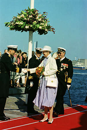 prince of denmark: DENMARK  COPENHAGEN_  (Files historic images )Queen Margrethe II and prince Henrik boading at boad to board on danneborg (royal yatch) on July 14, 1999